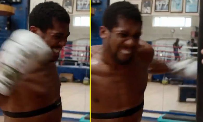 Watch as Anthony Joshua displays stunning upper body strength as he unleashes power hooks while sitting down