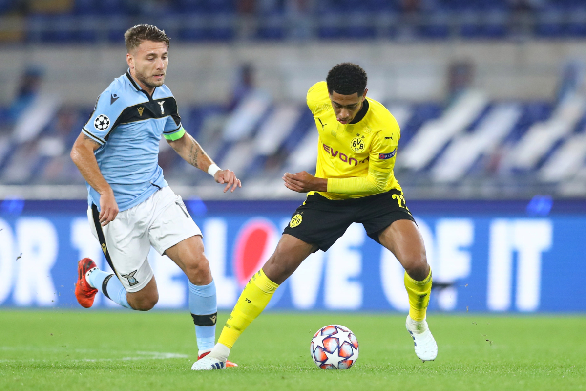 Jude Bellingham becomes youngest ever English player to feature in Champions League but is hooked off at half-time as Borussia Dortmund lose to Lazio