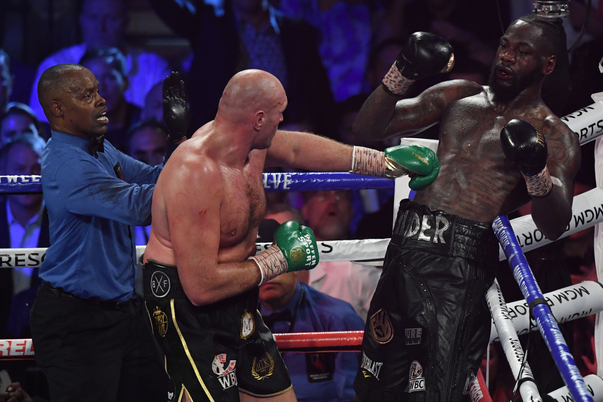 Deontay Wilder claims his water was 'spiked' before Tyson Fury rematch and accuses former trainer Mark Breland of being part of 'plot' to dethrone him