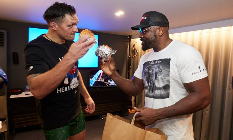 Watch heartwarming moment Dereck Chisora brings Oleksandr Usyk a burger in the dressing room as pair show respect after gruelling fight