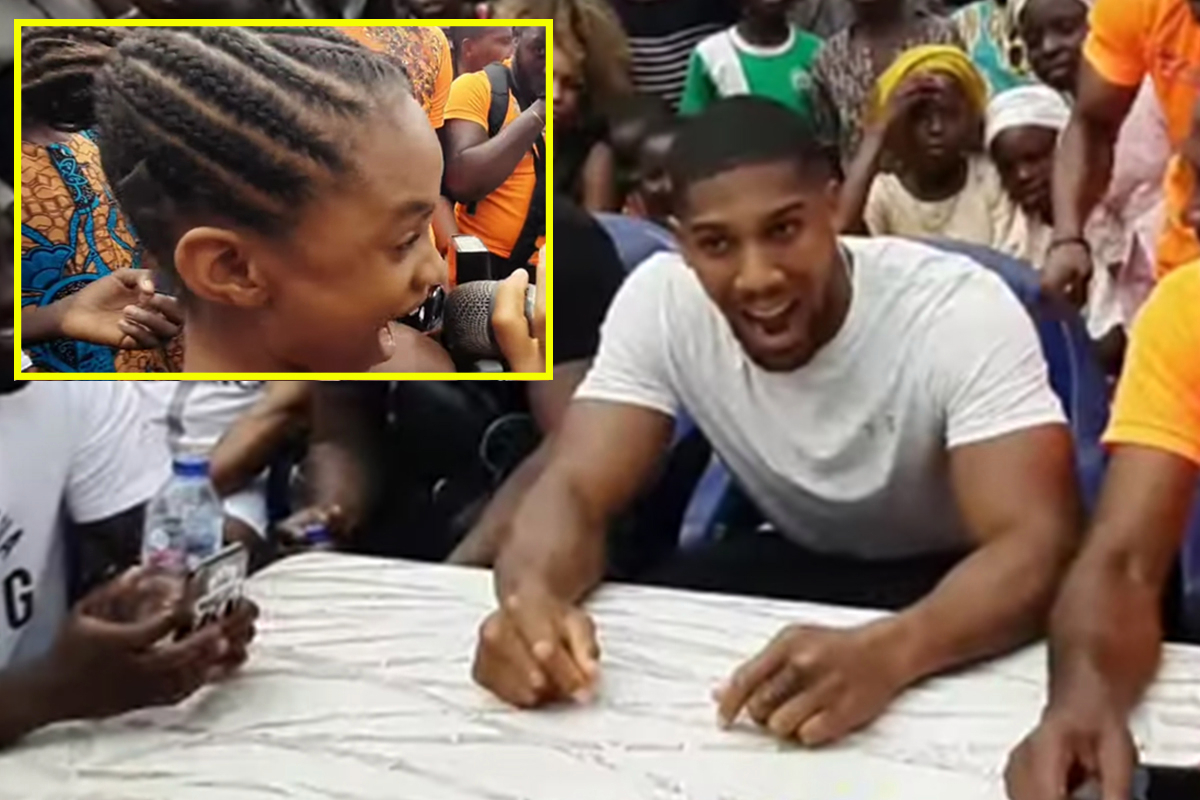 Watch when Anthony Joshua was put on spot by awkward question from little girl during visit to Nigeria slum
